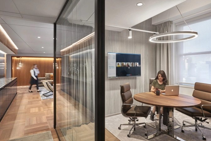 Create professional and inviting space with elegant glass partition